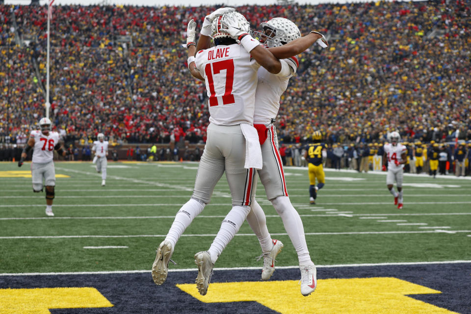 Ohio State wide receiver Chris Olave (17) and Garrett Wilson should be celebrating a lot more next season. (AP Photo/Paul Sancya)