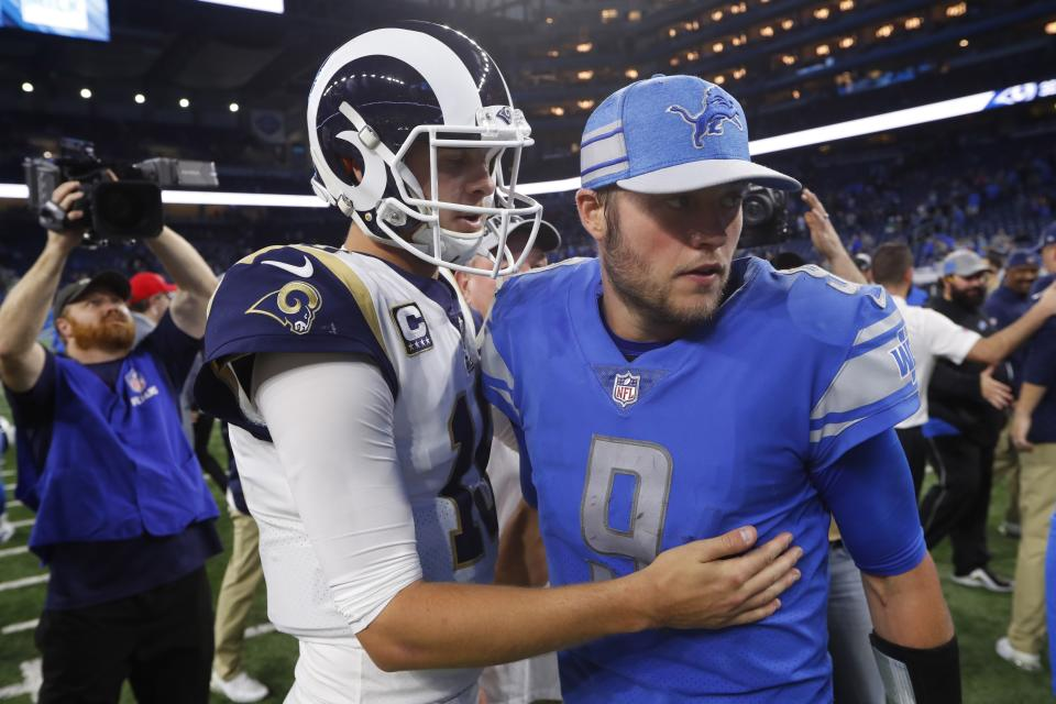 Los Angeles Rams quarterback Jared Goff, front left, meets with Detroit Lions quarterback Matthew Stafford after an NFL football game, Sunday, Dec. 2, 2018, in Detroit. (AP Photo/Paul Sancya)