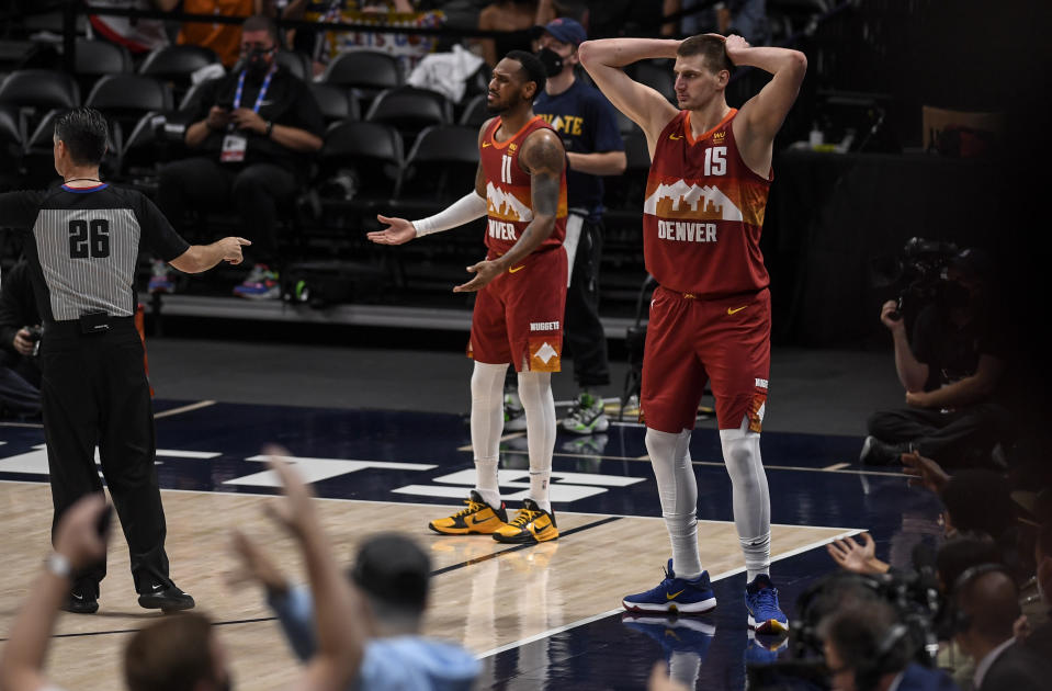 DENVER, CO - JUNE 13: Nikola Jokic (15) and Monte Morris (11) of the Denver Nuggets react to a call for a jump ball by referee Pat Fraher (26) during the second quarter against the Phoenix Suns at Ball Arena on Sunday, June 13, 2021. The Denver Nuggets hosted the Phoenix Suns for game four of their best-of-seven NBA Playoffs series. (Photo by AAron Ontiveroz/MediaNews Group/The Denver Post via Getty Images)