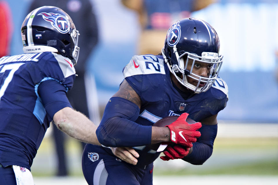 NASHVILLE, TENNESSEE - JANUARY 10: Quarterback Ryan Tannehill #17 hands off the ball to running back Derrick Henry #22 of the Tennessee Titans during their AFC Wild Card Playoff game against the Baltimore Ravens at Nissan Stadium on January 10, 2021 in Nashville, Tennessee. The Ravens defeated the Titans 20-13.  (Photo by Wesley Hitt/Getty Images)