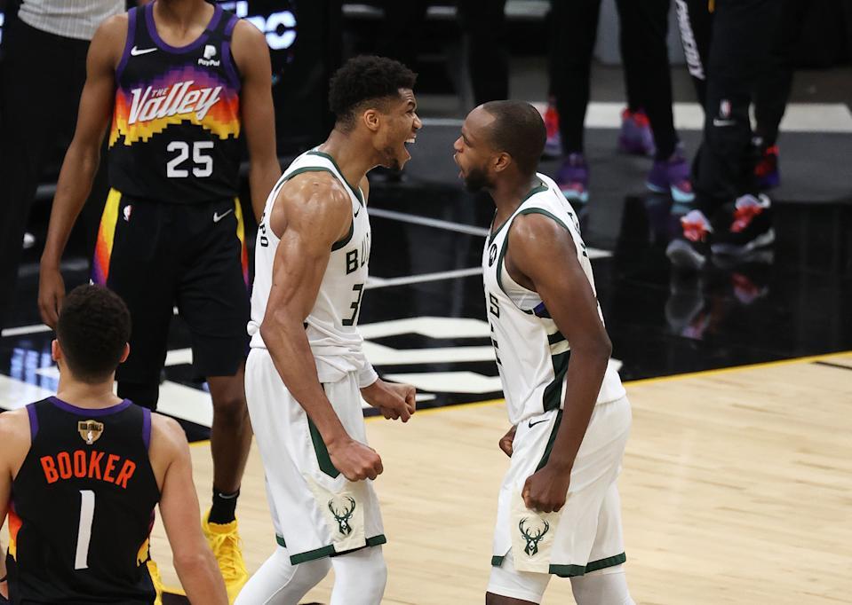 Milwaukee Bucks stars Giannis Antetokounmpo and Khris Middleton celebrate their pivotal Game 5 victory. (Ronald Martinez/Getty Images)