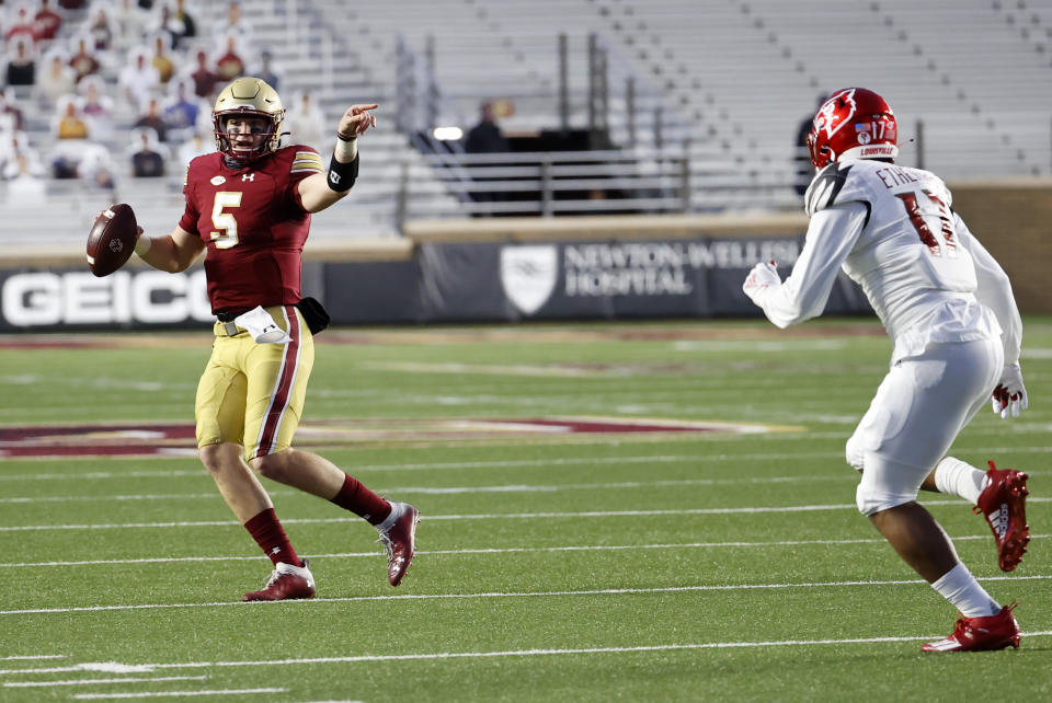 CHESTNUT HILL, MA - NOVEMBER 28: Boston College Eagles quarterback Phil Jurkovec (5) motions to a receiver as Louisville Cardinals inside linebacker Dorian Etheridge (17) moves in during a game between the Boston College Eagles and the Louisville Cardinals on November 28, 2020, at Alumni Stadium in Chestnut Hill, Massachusetts. (Photo by Fred Kfoury III/Icon Sportswire via Getty Images)
