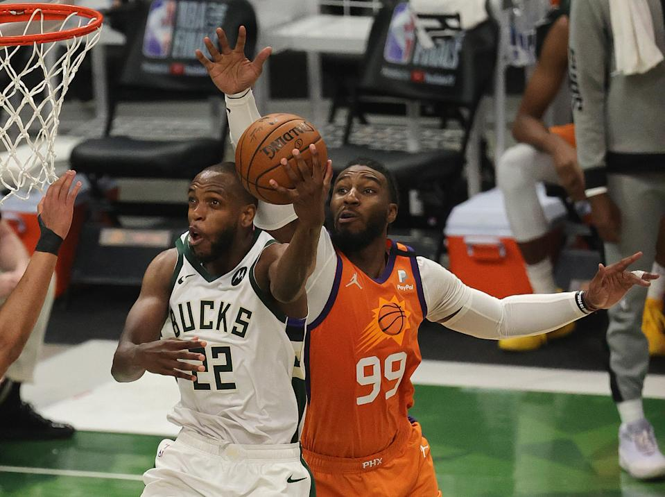 Khris Middleton drives for two of his 40 points in Game 4 of the NBA Finals. (Jonathan Daniel/Getty Images)