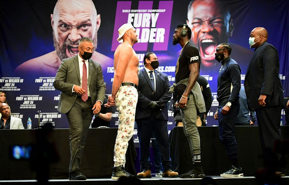 Boxers Tyson Fury and Deontay Wilder face-off.