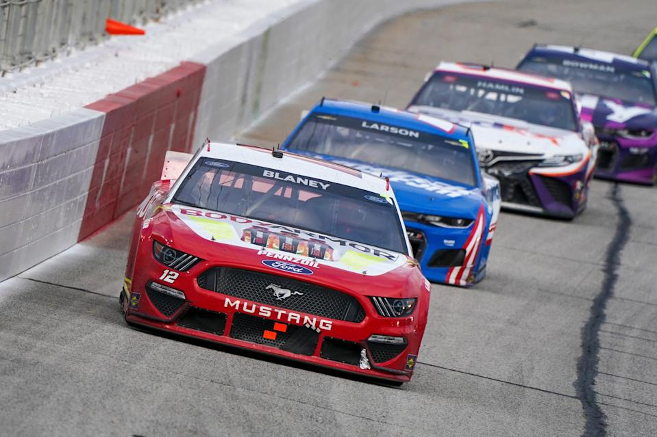 Ryan Blaney (12) leads driver Kyle Larson (5) during the closing laps of the spring race at Atlanta Motor Speedway on March 21, 2021.