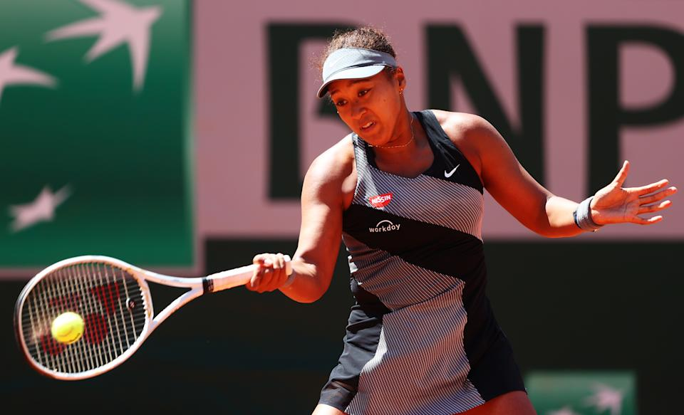 Naomi Osaka of Japan plays a forehand in her First Round match against Patricia Maria Tig of Romania during Day One of the 2021 French Open at Roland Garros on May 30, 2021 in Paris, France. (Photo by Julian Finney/Getty Images)