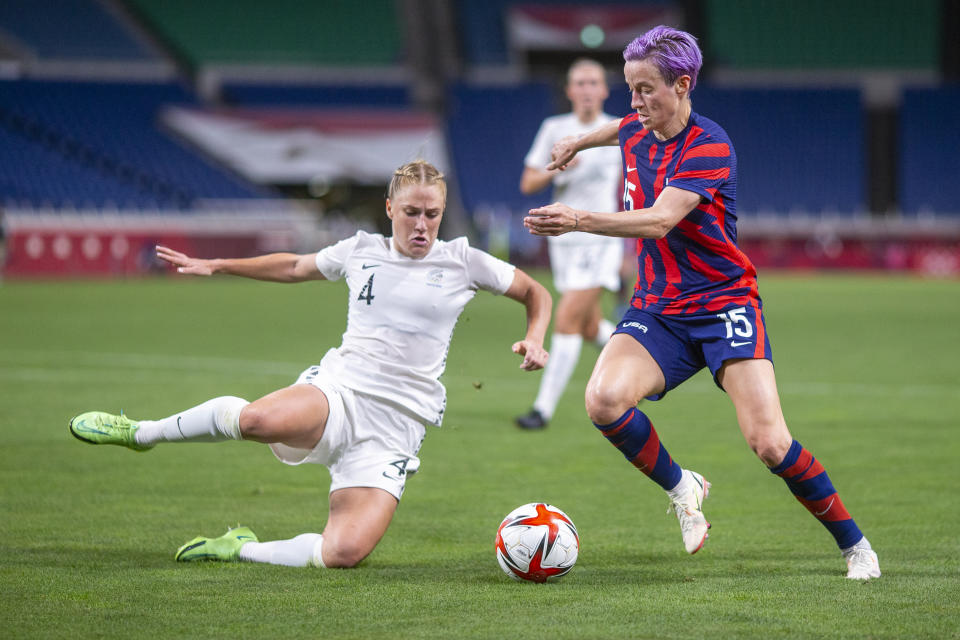 TOKYO, JAPAN - JULY 24: Megan Rapinoe #15 of the United States defended by C.J. Bott of New Zealand during the USA V New Zealand group G match at Saitama Stadium at the Tokyo 2020 Summer Olympic Games on July 24, 2021 in Tokyo, Japan. (Photo by Tim Clayton/Corbis via Getty Images)