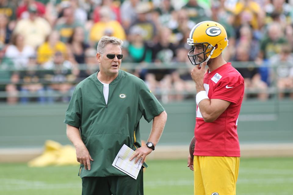 Green Bay Packers quarterback Aaron Rodgers talks with quarterback coach Frank Cignetti Jr. during Packers training camp on July 26, 2018. (Larry Radloff/Icon Sportswire via Getty Images)