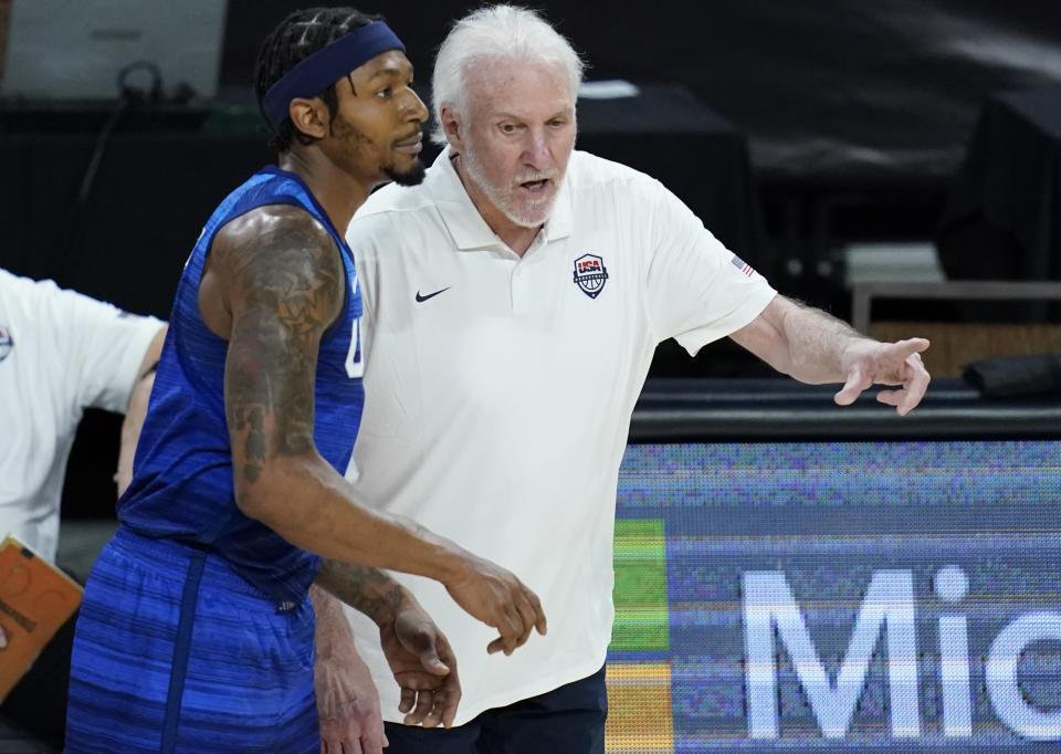 Team USA head coach Gregg Popovich and Bradley Beal talk during an exhibition basketball game against Australia on Monday in Las Vegas. (AP Photo/John Locher)
