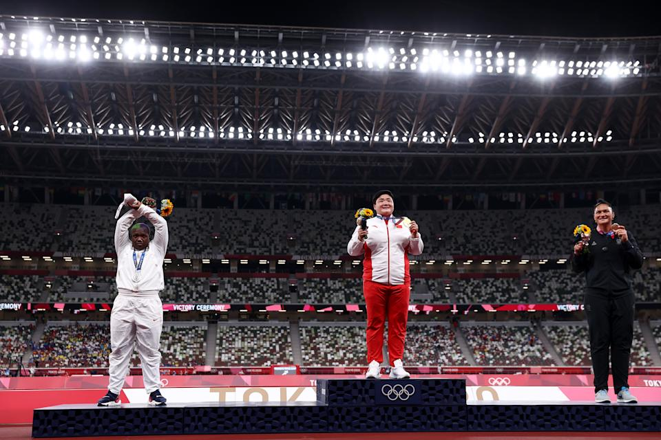 TOKYO, JAPAN - AUGUST 01: (L-R) Silver medalist Raven Saunders of Team United States, gold medalist Lijiao Gong of Team China and bronze medalist Valerie Adams of Team New Zealand pose with their medals during the medal ceremony for the Women's Shot Put on day nine of the Tokyo 2020 Olympic Games at Olympic Stadium on August 01, 2021 in Tokyo, Japan. (Photo by Ryan Pierse/Getty Images)