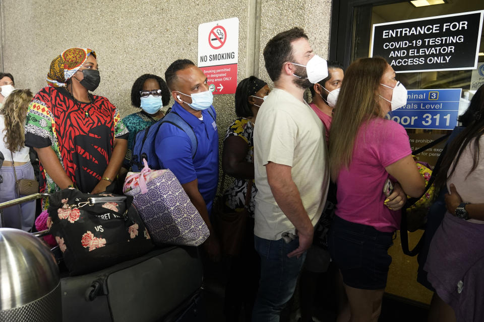 Passengers wait in a long line to get a COVID-19 test to travel overseas at Fort Lauderdale-Hollywood International Airport, Friday, Aug. 6, 2021, in Fort Lauderdale, Fla.. (AP Photo/Marta Lavandier)