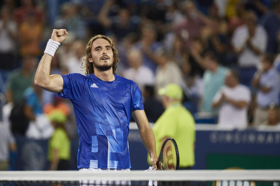 CINCINNATI, OH - AUGUST 20:  Stefanos Tsitsipas of Greece smiles at the crowd a does a fist pump after winning the quarterfinal match  against Felix Auger-Aliassime of Canada on day 5 of the Western & Southern Open at the Lindner Family Tennis Center in Mason, Ohio on August 20, 2021. (Photo by Shelley Lipton/Icon Sportswire via Getty Images)