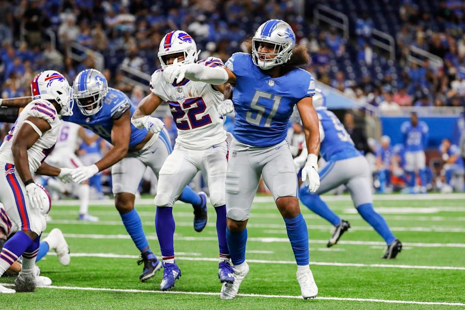 Detroit Lions linebacker Jahlani Tavai defends against Buffalo Bills running back Matt Breida (22) during the first half of the preseason game at Ford Field in Detroit on Friday, Aug. 13, 2021.