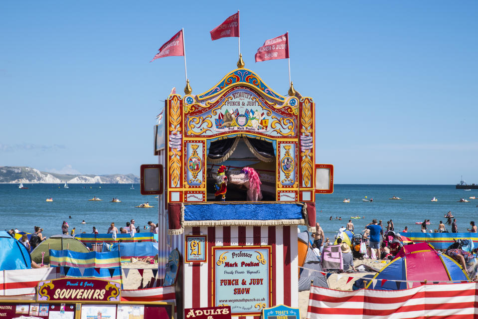 WEYMOUTH, UK - AUGUST 15TH 2017: A Punch and Judy show taking place on the beautiful Weymouth seafront in Dorset, UK, on 15th August 2017.