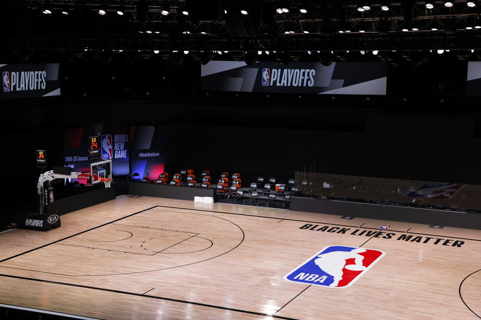 LAKE BUENA VISTA, FLORIDA - AUGUST 26: An empty court and bench is shown with no signage following the scheduled start time in Game Five of the Eastern Conference First Round between the Milwaukee Bucks and the Orlando Magic during the 2020 NBA Playoffs at AdventHealth Arena at ESPN Wide World Of Sports Complex on August 26, 2020 in Lake Buena Vista, Florida. The Milwaukee Buck have boycotted game 5 reportedly to protest the shooting of Jacob Blake in Kenosha, Wisconsin. NOTE TO USER: User expressly acknowledges and agrees that, by downloading and or using this photograph, User is consenting to the terms and conditions of the Getty Images License Agreement. (Photo by Kevin C. Cox/Getty Images)