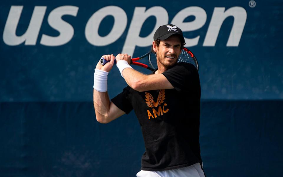 Andy Murray of Great Britain practices with Jordan Thompson of Australia at the USTA Billie Jean King National Tennis Center on August 26, 2021 in New York City. - GETTY IMAGES