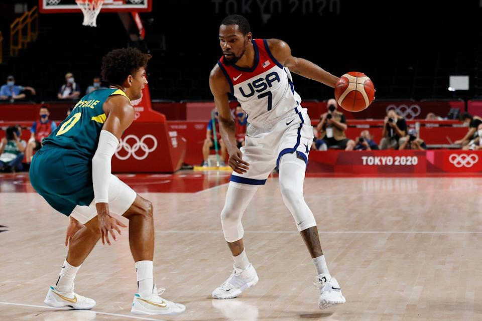 United States forward Kevin Durant dribbles the ball as Australia guard Matisse Thybulle defends in the first quarter during the Tokyo 2020 Olympic Summer Games at Saitama Super Arena.