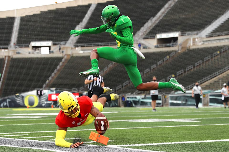EUGENE, OREGON - MAY 01: Robby Ashford #6 of the Oregon Ducks dives to score a touchdown against Bryan Addison #13 of the Oregon Ducks on the final play of the game in the fourth quarter during the Oregon spring game at Autzen Stadium on May 01, 2021 in Eugene, Oregon. (Photo by Abbie Parr/Getty Images)