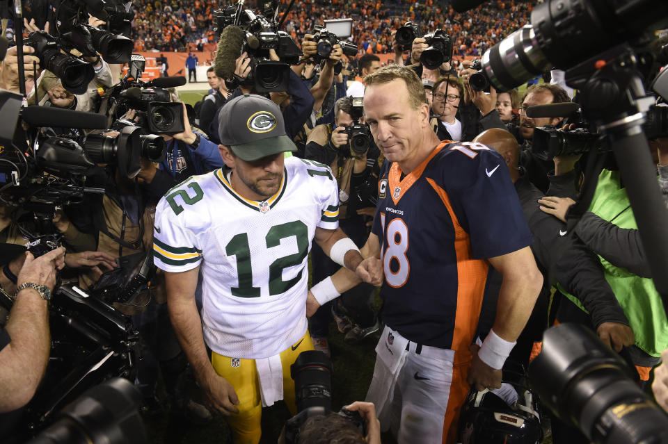 Denver Broncos quarterback Peyton Manning and Green Bay Packers quarterback Aaron Rodgers greet each other following Denver's 29-10 win on Sunday, Nov. 1, 2015, at Sports Authority Field at Mile High Stadium in Denver. (Mark Reis/Colorado Springs Gazette/Tribune News Service via Getty Images)