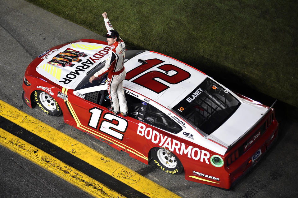 DAYTONA BEACH, FLORIDA - AUGUST 28: Ryan Blaney, driver of the #12 BodyArmor Ford, celebrates after winning the NASCAR Cup Series Coke Zero Sugar 400 at Daytona International Speedway on August 28, 2021 in Daytona Beach, Florida. (Photo by Logan Riely/Getty Images)