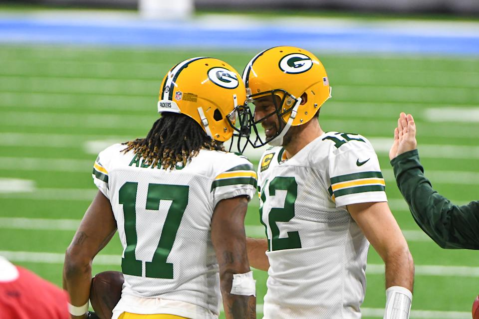 Green Bay Packers wide receiver Davante Adams (17) is congratulated by Green Bay Packers quarterback Aaron Rodgers (12)
