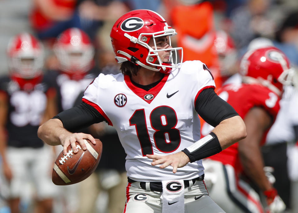 ATHENS, GA - APRIL 17: Quarterback JT Daniels #18 of the Georgia Bulldogs drops back to pass during the second half of the G-Day spring game at Sanford Stadium on April 17, 2021 in Athens, Georgia. (Photo by Todd Kirkland/Getty Images)