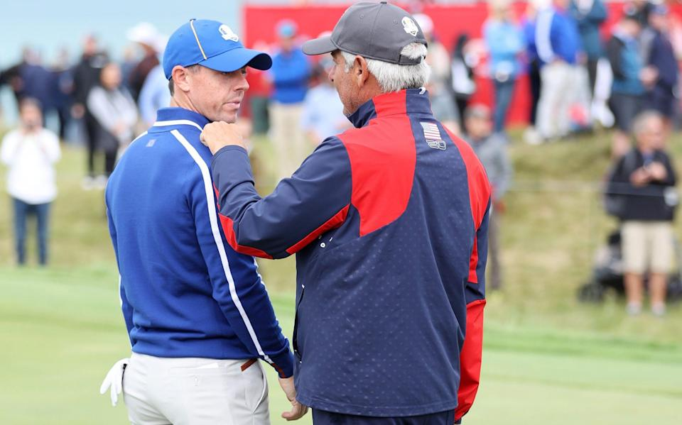 Rory McIlroy (left) chats with Team USA vice-captain Fred Couples - GETTY IMAGES