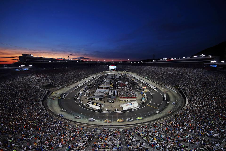 NASCAR Cup Series drivers race during the Bass Pro Shops Night Race at Bristol Motor Speedway.