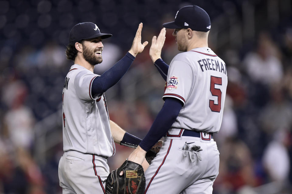 WASHINGTON, DC - AUGUST 14: Dansby Swanson #7 and Freddie Freeman #5 of the Atlanta Braves celebrate after a 12-2 victory against the Washington Nationals at Nationals Park on August 14, 2021 in Washington, DC. (Photo by G Fiume/Getty Images)
