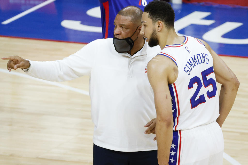PHILADELPHIA, PENNSYLVANIA - APRIL 28: Head coach Doc Rivers of the Philadelphia 76ers speaks with Ben Simmons #25 during the first quarter against the Atlanta Hawks at Wells Fargo Center on April 28, 2021 in Philadelphia, Pennsylvania. NOTE TO USER: User expressly acknowledges and agrees that, by downloading and or using this photograph, User is consenting to the terms and conditions of the Getty Images License Agreement. (Photo by Tim Nwachukwu/Getty Images)