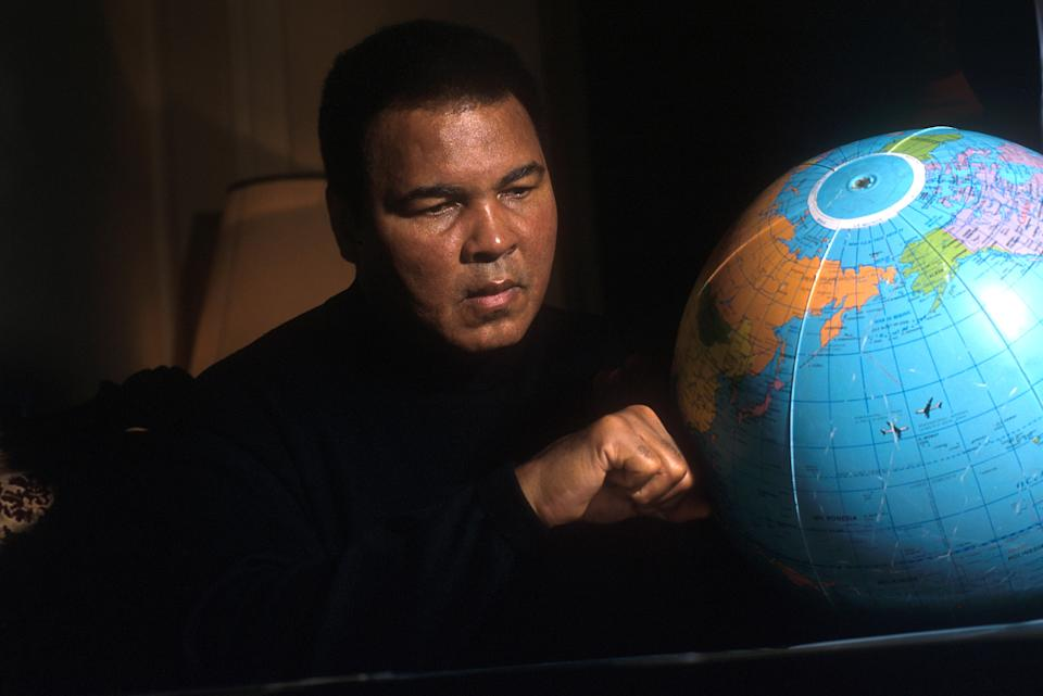 ROME, ITALY - FEBRUARY 06:  Muhammad Ali punches a globe at the Plaza Hotel on February 6, 2001 in Rome, Italy. The great career of the most famous American boxer is highlighted by an Olympic gold medal in light- heavyweight at the Rome 1960 Games and three World Heavyweight Champion titles. Ali was also crowned Sportsman of the Century by Sports Illustrated and the BBC.  (Photo by Franco Origlia/Getty Images)