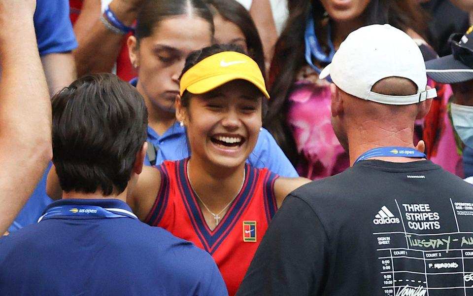 Emma Raducanu of Great Britain celebrates with her coach Andrew Richardson after defeating Leylah Annie Fernandez of Canada during the second set of their Women's Singles final match on Day Thirteen of the 2021 US Open at the USTA Billie Jean King National Tennis Center on September 11, 2021 in the Flushing neighborhood of the Queens borough of New York City - From Darren Cahill to Andy Murray - who should Emma Raducanu appoint as her next coach? - GETTY IMAGES