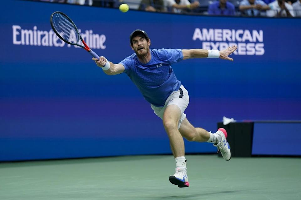 Andy Murray reaches to return a shot