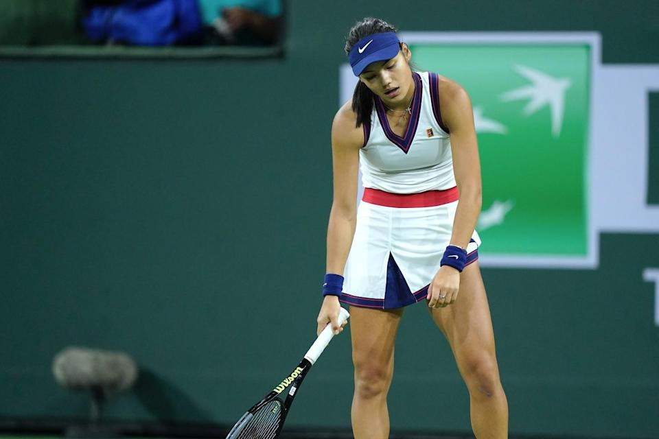 Emma Raducanu reacts after losing a point to Aliaksandra Sasnovich at the BNP Paribas Open.