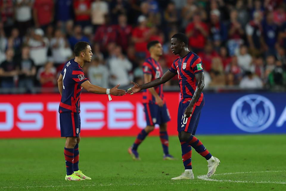 COLUMBUS, OH - OCTOBER 13: Tim Weah #20 of United States celebrates with his teammate Sergiño Dest #2 after scoring the second goal of his team during the FIFA World Cup Qatar 2022 qualifiers match between United States and Costa Rica at Lower.com Field on October 13, 2021 in Columbus, Ohio. (Photo by Omar Vega/Getty Images)