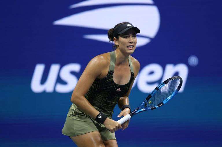 Muguruza rallies past Jabeur to win WTA Chicago title