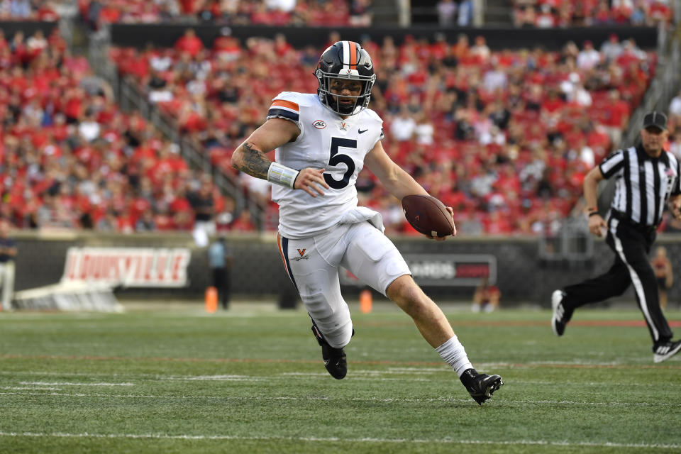 Virginia quarterback Brennan Armstrong (5) scrambles for the end zone during the second half of an NCAA college football game against Louisville in Louisville, Ky., Saturday, Oct. 9, 2021. Virginia won 34-33. (AP Photo/Timothy D. Easley)