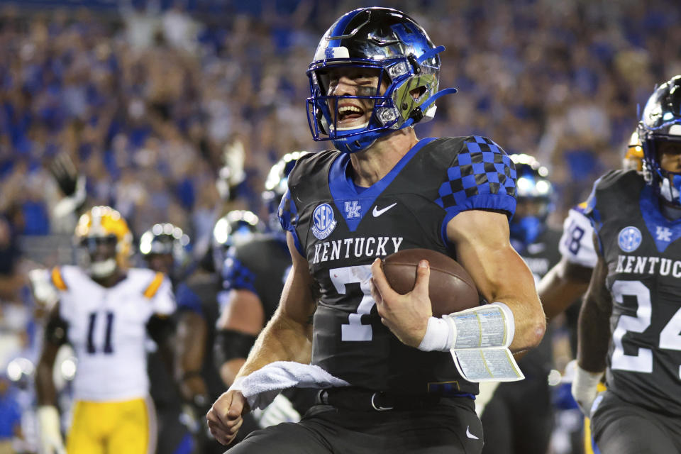 Kentucky quarterback Will Levis smiles as he scores a touchdown during the second half of the team's NCAA college football game against LSU in Lexington, Ky., Saturday, Oct. 9, 2021. (AP Photo/Michael Clubb)