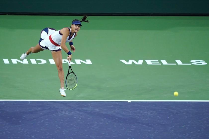 Emma Raducanu serves to Alaksandra Sasnovich at the BNP Paribas Open tennis tournament.