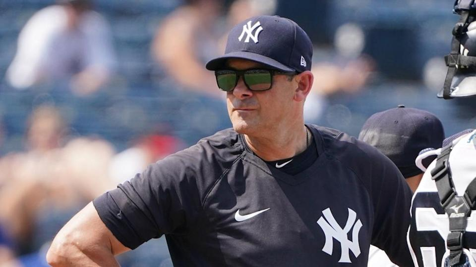 Aaron Boone with hand on hip at pitchers mound