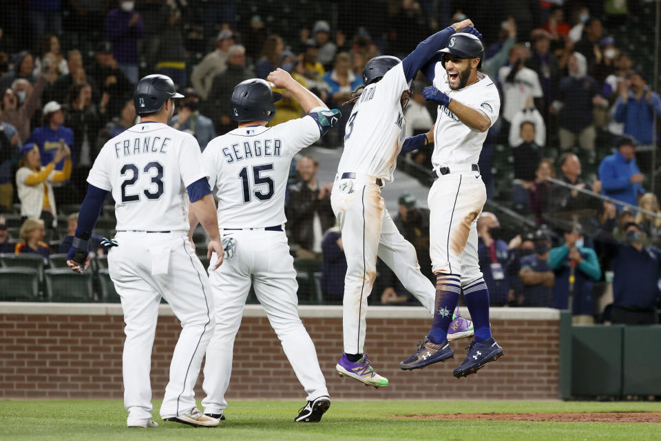 SEATTLE, WASHINGTON - AUGUST 31: Abraham Toro #13 of the Seattle Mariners reacts after his grand slam home run with Ty France #23, Kyle Seager #15 and J.P. Crawford #3 during the eighth inning against the Houston Astros at T-Mobile Park on August 31, 2021 in Seattle, Washington. (Photo by Steph Chambers/Getty Images)