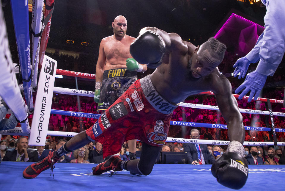 LAS VEGAS, NEVADA - OCTOBER 09:  Deontay Wilder (R) is knocked out by Tyson Fury in the 11th round during their WBC heavyweight title fight at T-Mobile Arena on October 09, 2021 in Las Vegas, Nevada.  (Photo by Al Bello/Getty Images)