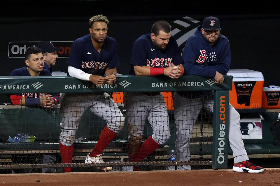 BALTIMORE, MARYLAND - SEPTEMBER 30: Xander Bogaerts #2 (L) and Kyle Schwarber #18 of the Boston Red Sox look on from the dugout during the ninth inning of the Red Sox 6-2 loss to the Baltimore Orioles at Oriole Park at Camden Yards on September 30, 2021 in Baltimore, Maryland. (Photo by Rob Carr/Getty Images)