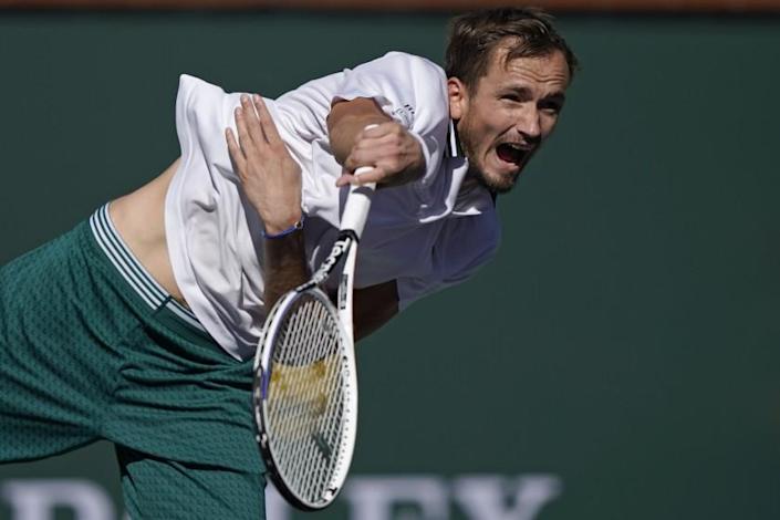 Daniil Medvedev, of Russia, serves to Grigor Dimitrov, of Bulgaria, at the BNP Paribas Open tennis tournament Wednesday, Oct. 13, 2021, in Indian Wells, Calif. (AP Photo/Mark J. Terrill)