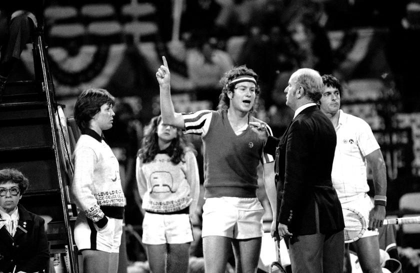 John McEnroe gesture angrily in 1980 as he argues call with umpire Joey Lessing and head referee Fred Hoyles