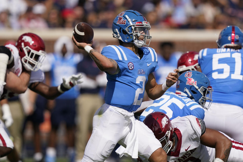 Mississippi quarterback Matt Corral (2) passes against Arkansas during the first half of an NCAA college football game, Saturday, Oct. 9, 2021, in Oxford, Miss. Mississippi won 52-51. (AP Photo/Rogelio V. Solis)