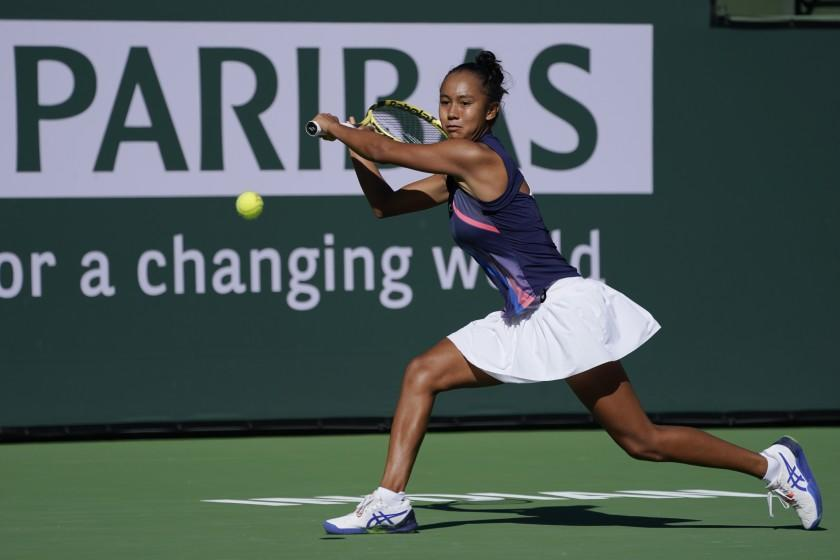 Leylah Fernandez, of Canada, returns a shot to Shelby Rogers at the BNP Paribas Open.