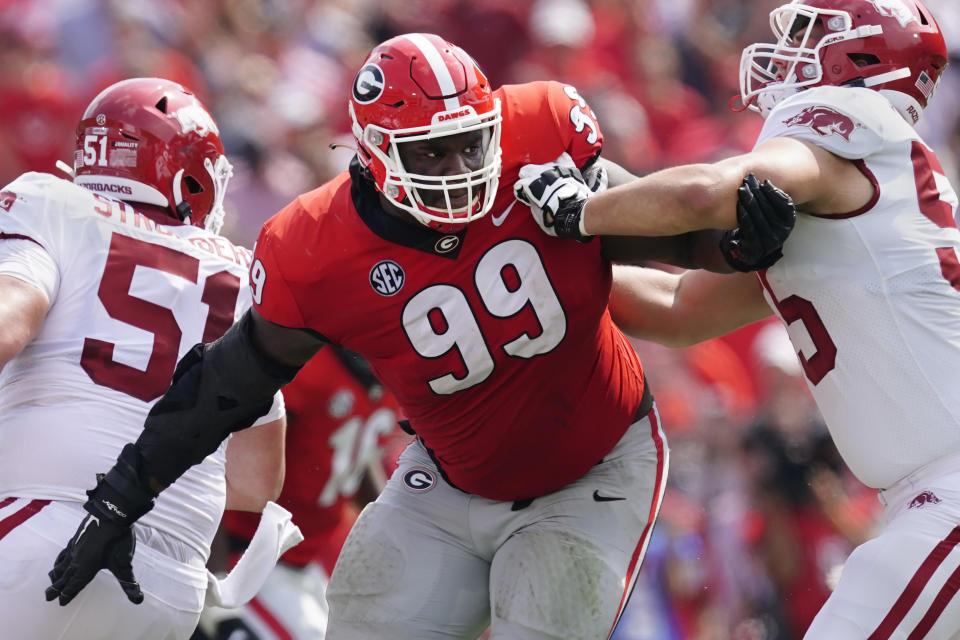 Georgia defensive lineman Jordan Davis (99) shown in action during the first half of an NCAA college football game against Arkansas Saturday, Oct. 2, 2021, in Athens, Ga. (AP Photo/John Bazemore)